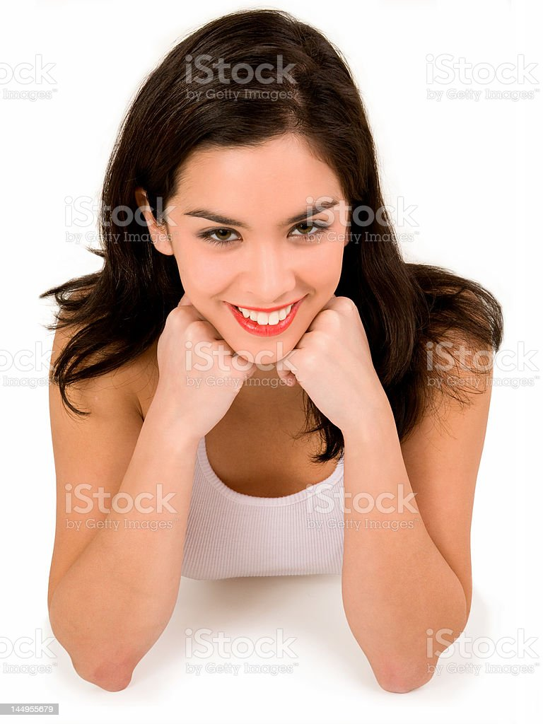 Beautiful Smiling Brunette Resting on her Elbows royalty-free stock photo