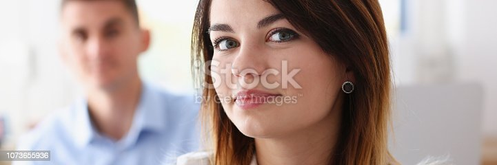 istock Beautiful smiling businesswoman portrait at workplace 1073655936