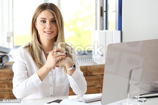 istock Beautiful smiling businesswoman portrait at workplace 825155270