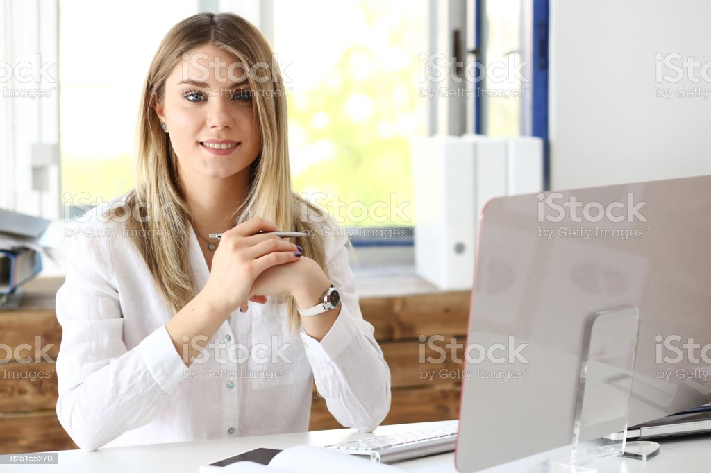 Beautiful smiling businesswoman portrait at workplace stock photo