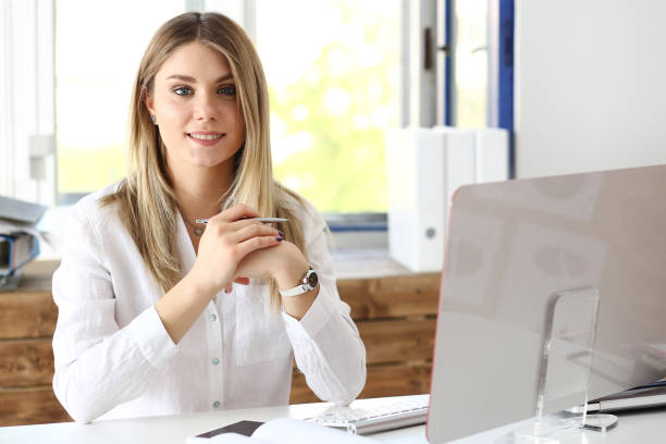 beautiful smiling businesswoman portrait at workplace - assistant stock pictures, royalty-free photos & images