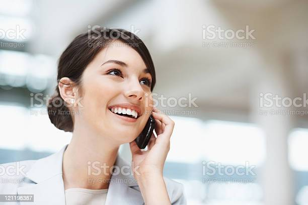 Beautiful Smiling Businesswoman Talking On A Cellphone Stock Photo - Download Image Now