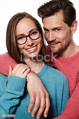 istock Beautiful smiling couple in studio, close up 621135492
