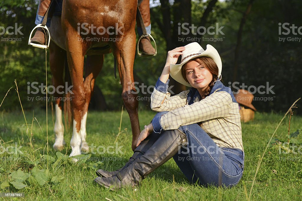 Beautiful Smiling Cowgirl with horse royalty-free stock photo
