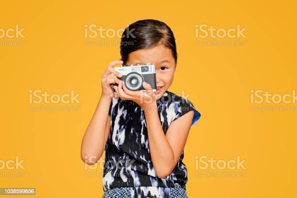 Beautiful smiling girl holding a camera picture id1038599856?b=1&k=6&m=1038599856&s=612x612&h=x8dlirlesddp8nccd1z2snfztfnlldmlkkhyvoeb5ty=
