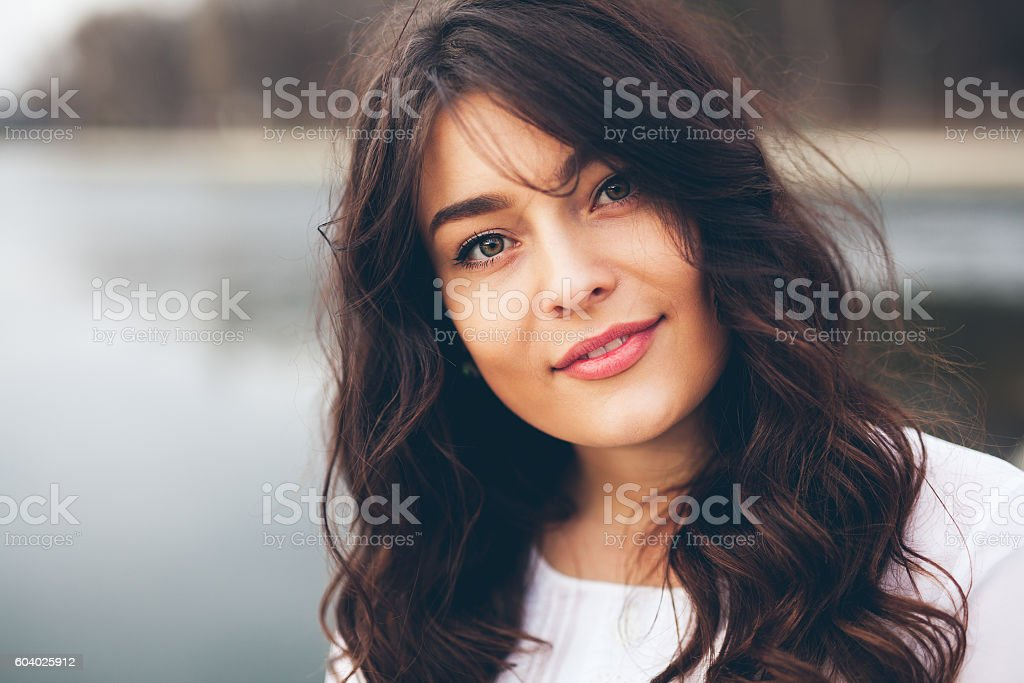 Beautiful smiling plump girl stock photo