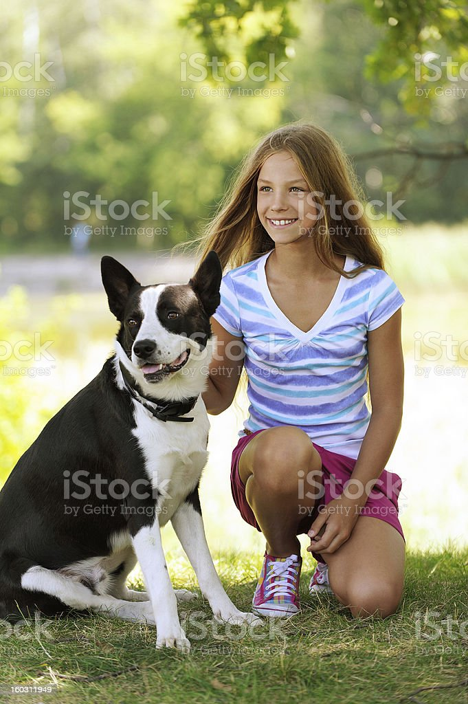 beautiful smiling girl with black dog royalty-free stock photo