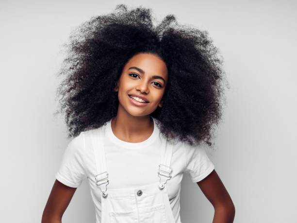 Beautiful smiling girl with curly hairstyle stock photo