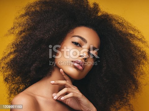 Beautiful smiling girl with curly hairstyle