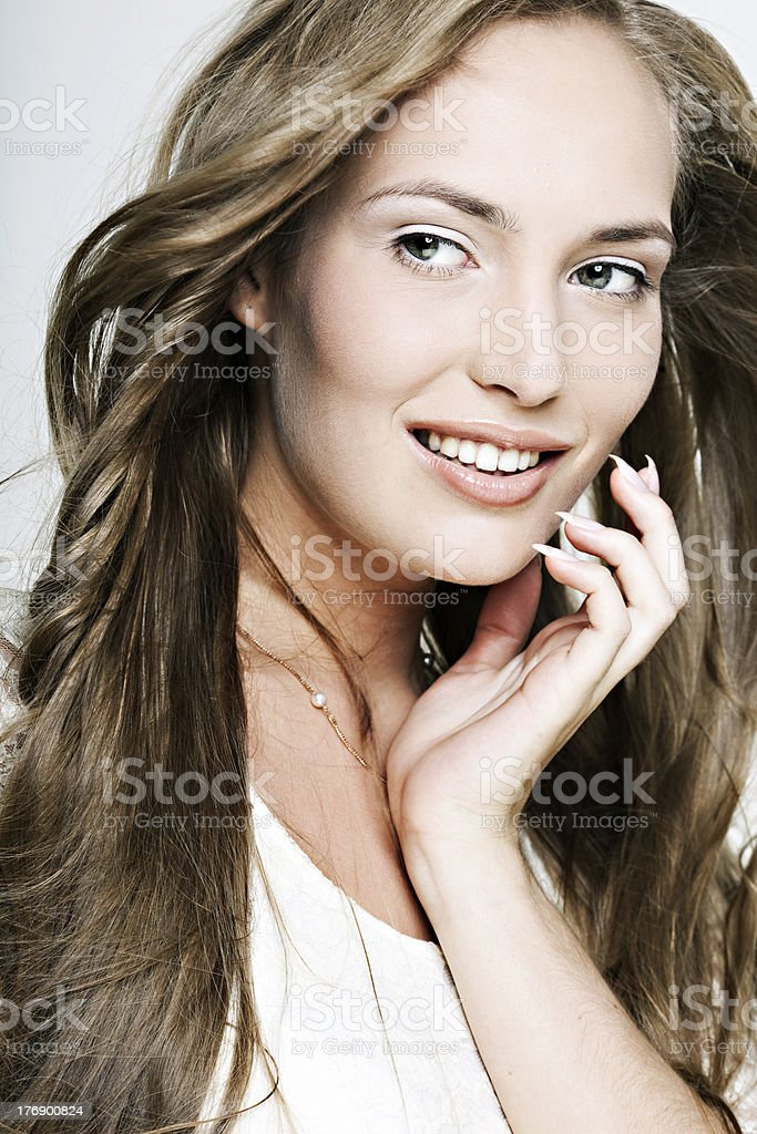 beautiful smiling girl with long wonderful hair royalty-free stock photo