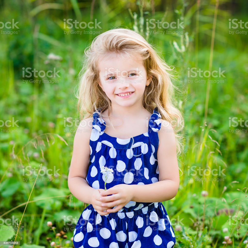 Beautiful Smiling Little Girl With Long Blond Curly Hair Stock Photo - Download Image Now - iStock