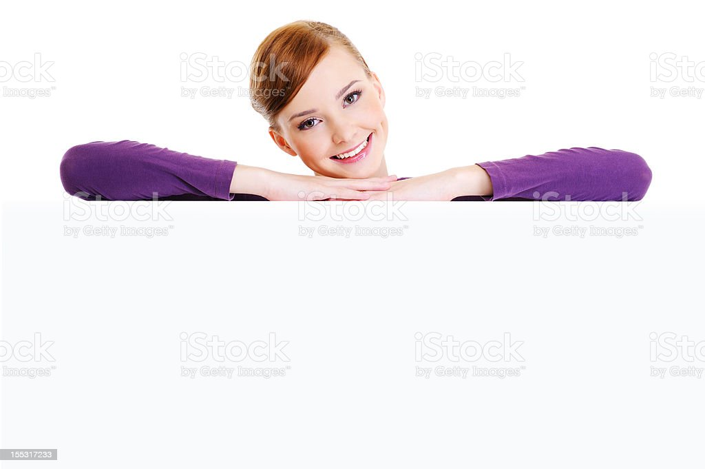 beautiful smiling woman above the white blank banner royalty-free stock photo