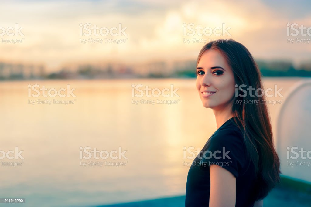 Beautiful Smiling Woman be the Sea at Sunset Time stock photo