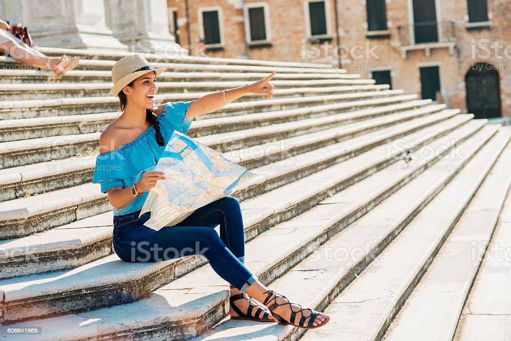 beautiful smiling woman exploring the city stock photo