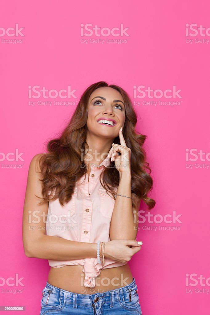 Beautiful Smiling Woman Looking Up royalty-free stock photo