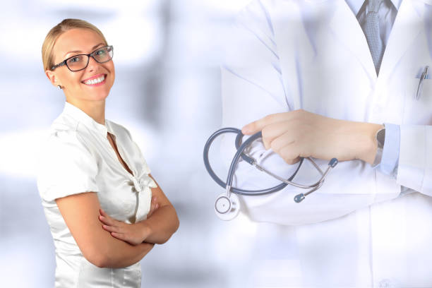 Beautiful smiling woman. Medicine. Doctor standing with stethoscope stock photo