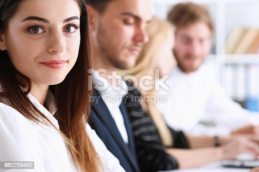 istock Beautiful smiling woman portrait with group 882259402