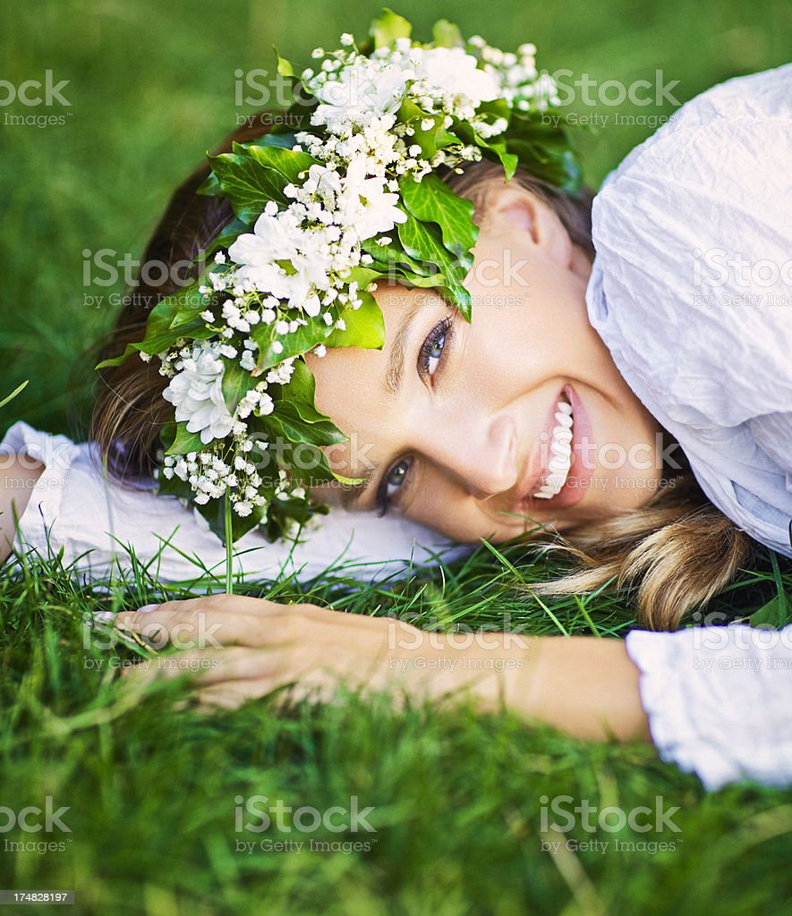 Beautiful smiling woman with a flower wreath on her head royalty-free stock photo