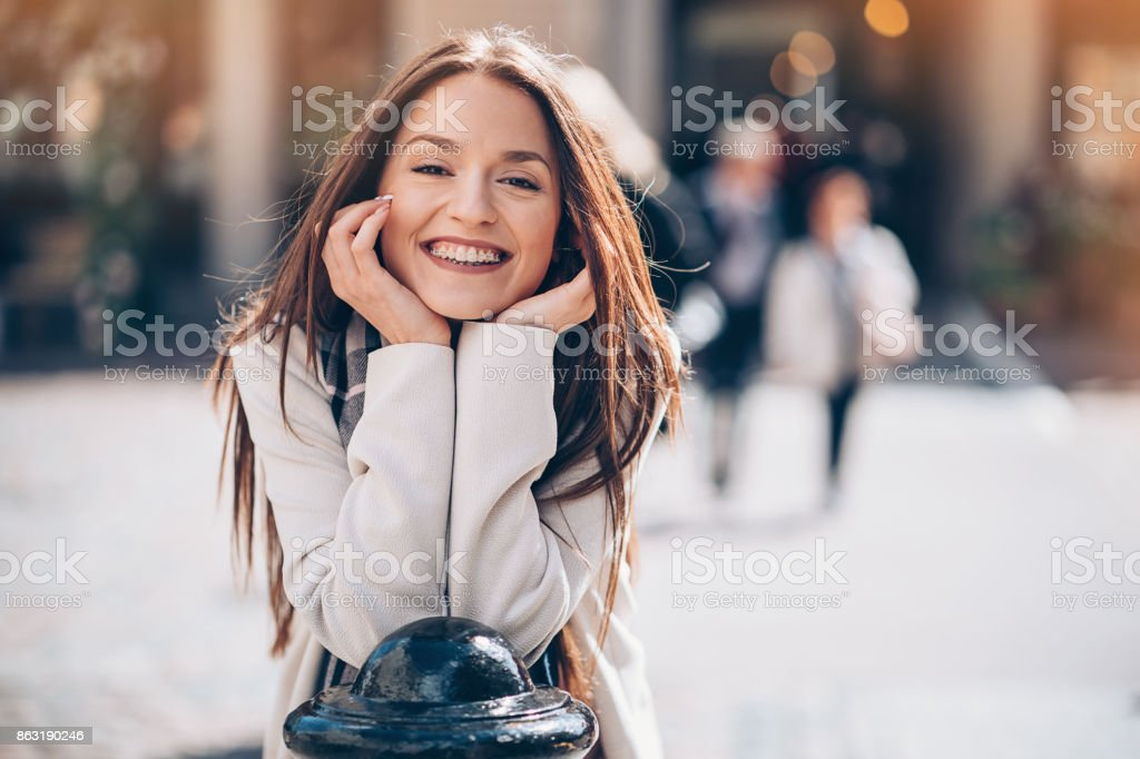 Beautiful smiling woman with braces стоковое фото