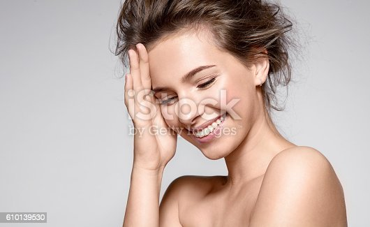 istock Beautiful smiling woman with clean skin and white teeth 610139530