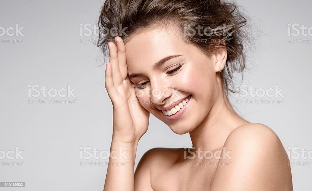 Beautiful smiling woman with clean skin and white teeth stock photo
