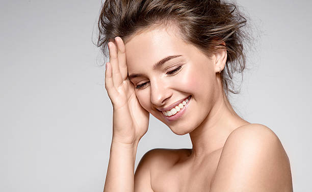 Beautiful smiling woman with clean skin and white teeth ストックフォト