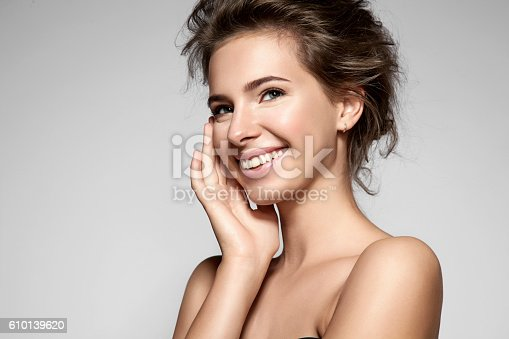istock Beautiful smiling woman with clean skin, natural make-up 610139620