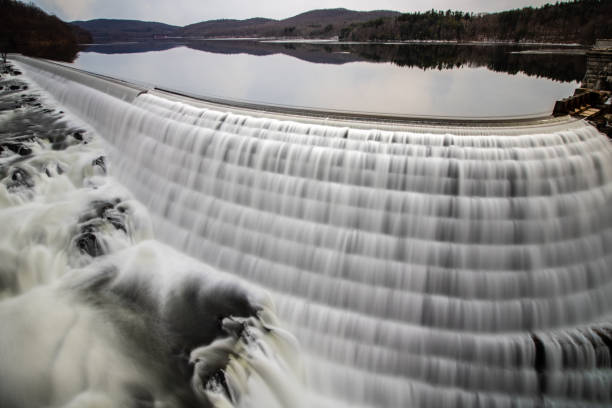 Beautiful smooth water cascading down a man made dam, flowing from a reservoir.