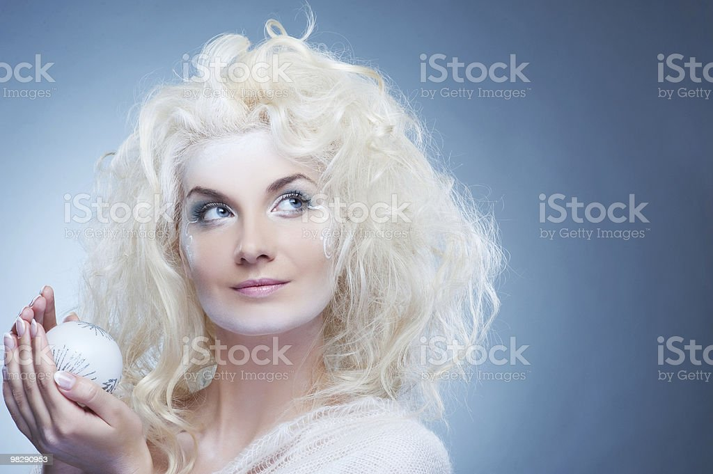 Beautiful snow queen with a christmas ball royalty-free stock photo