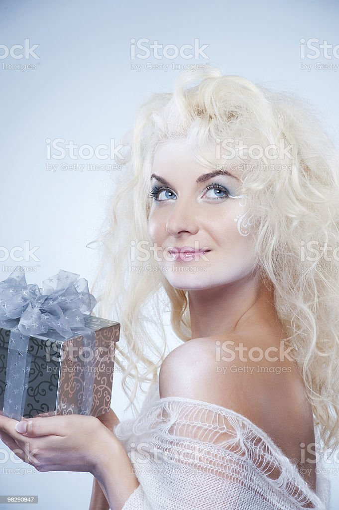 Beautiful snow queen with a christmas box royalty-free stock photo