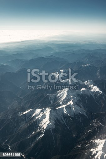 istock Beautiful snowy mountains in winter 898661496