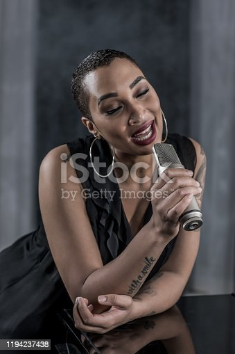 Beautiful Soul singer black woman during a duet in a jazz club setting