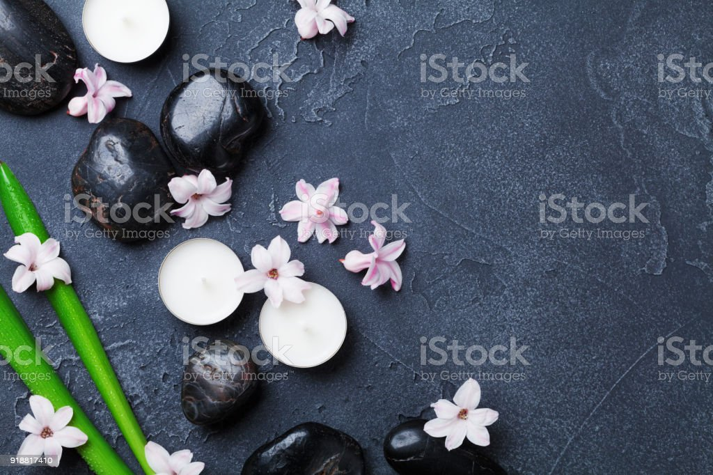 Beautiful spa background with massage pebble, green leaves, flowers...