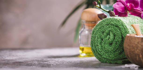 beautiful spa products on concrete background - spa belgium stock photos and pictures