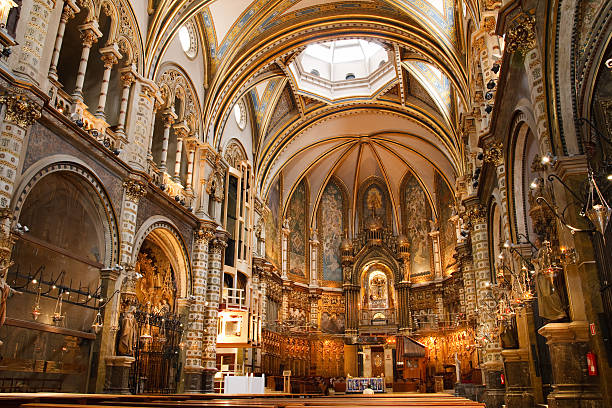 Beautiful Spanish Basilica at the Montserrat Monastery Basilica at the Montserrat Monastery, a spectacularly beautiful Benedictine Abbey high up in the mountains near Barcelona, Catalonia, Spain. abbey monastery stock pictures, royalty-free photos & images