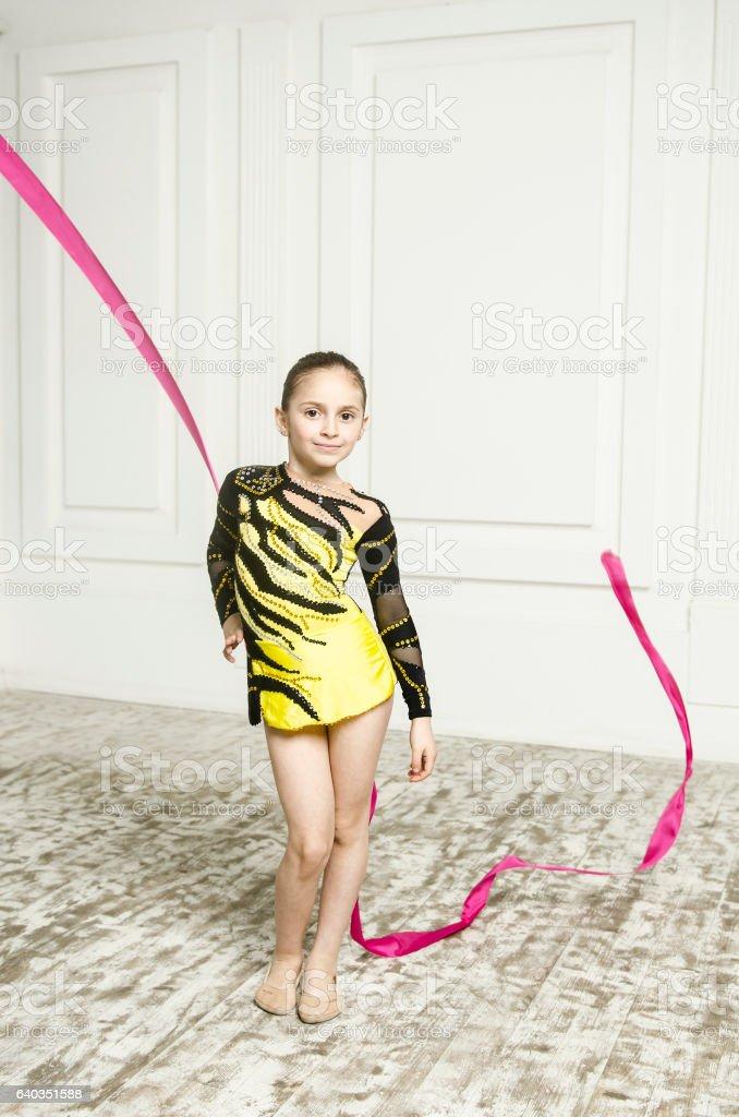 Beautiful sport training rhythmic gymnastic girl stock photo