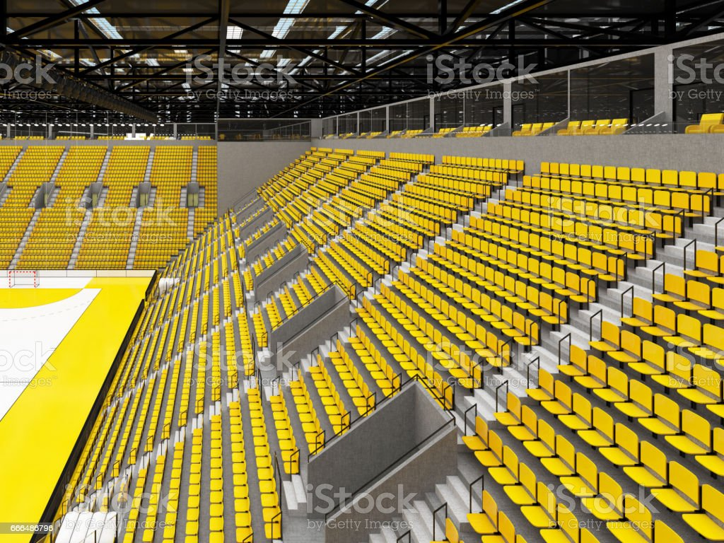 Beautiful sports arena for handball with yellow seats and VIP boxes