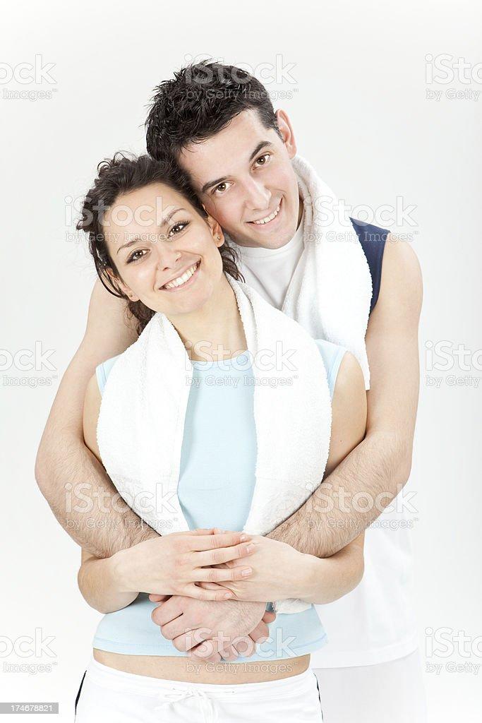 beautiful sports couple hug pose after training isolated on whit royalty-free stock photo