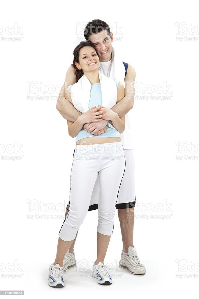 beautiful sports couple hug pose after training isolated on whit