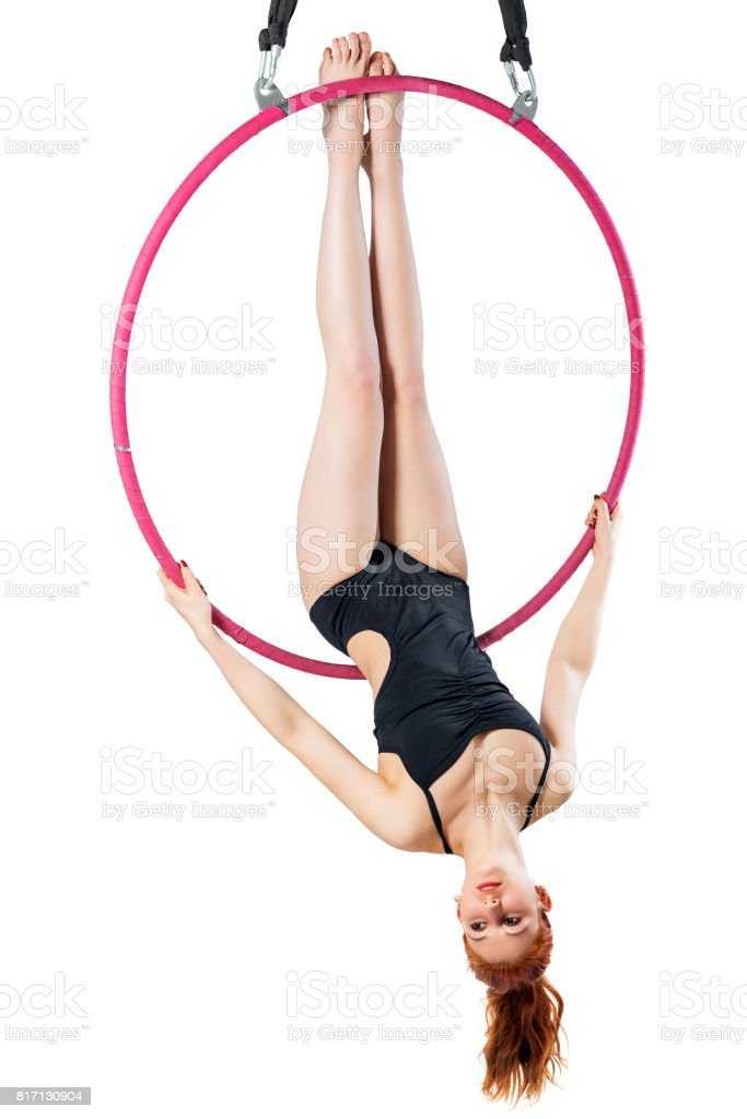 Beautiful sportswoman in an airy ring trains on a white background stock photo