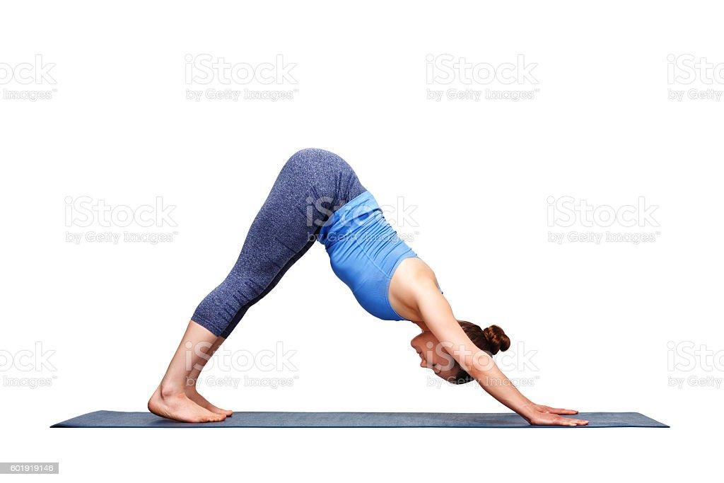 Beautiful sporty fit yogi girl practices yoga asana adhomukha sv stock photo