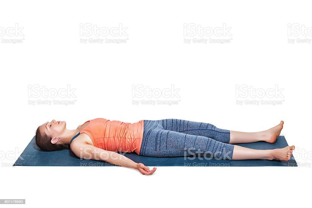 Beautiful sporty fit yogi girl relaxes in yoga asana Savasana stock photo
