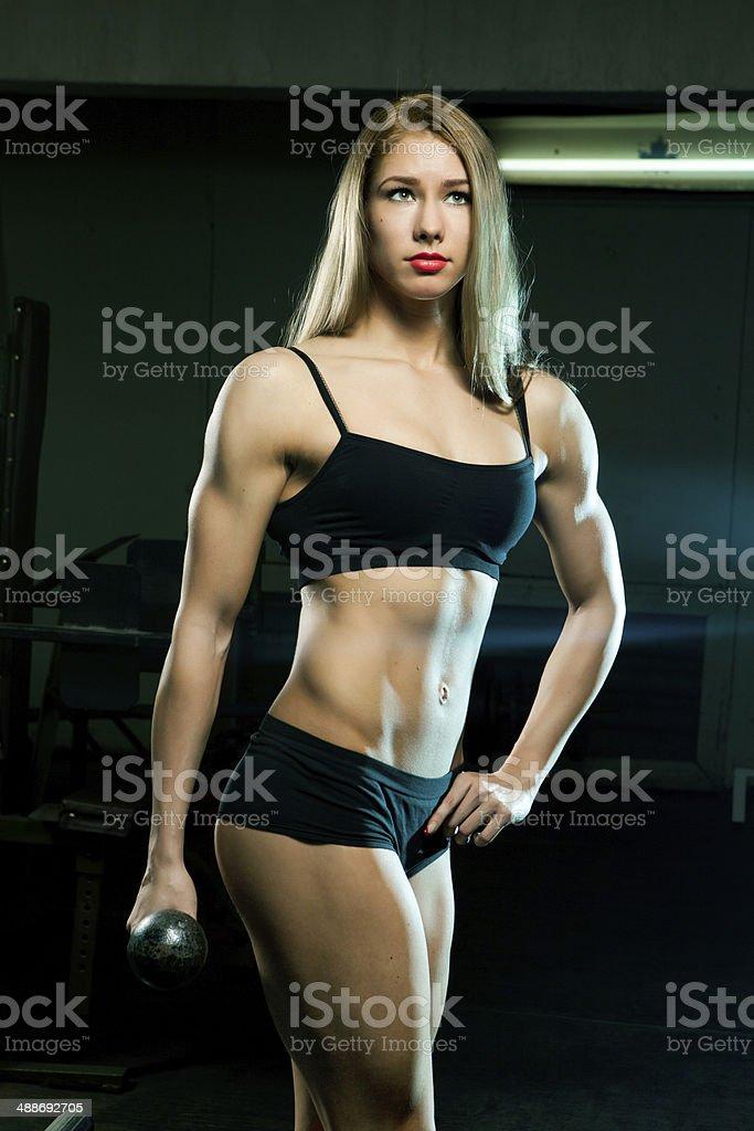 Beautiful sporty muscular woman royalty-free stock photo