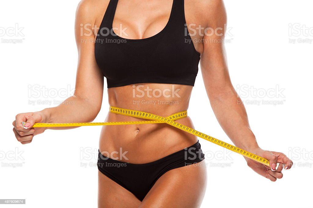 Beautiful sporty woman body with yellow measure on white background stock photo