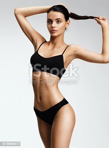 676005390istockphoto Beautiful sporty woman in black bikini 675994672