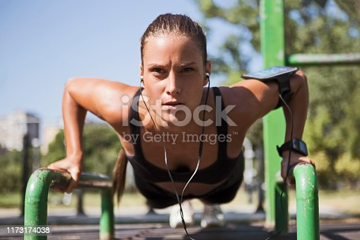 Beautiful sporty woman is working out outdoors