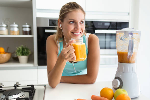 Beautiful sporty young woman looking sideways and drinking vegetable picture id1070187246?b=1&k=6&m=1070187246&s=612x612&w=0&h=dmke6yy43w3tabztuzehbeg5g1jvsussyi5hfctimow=