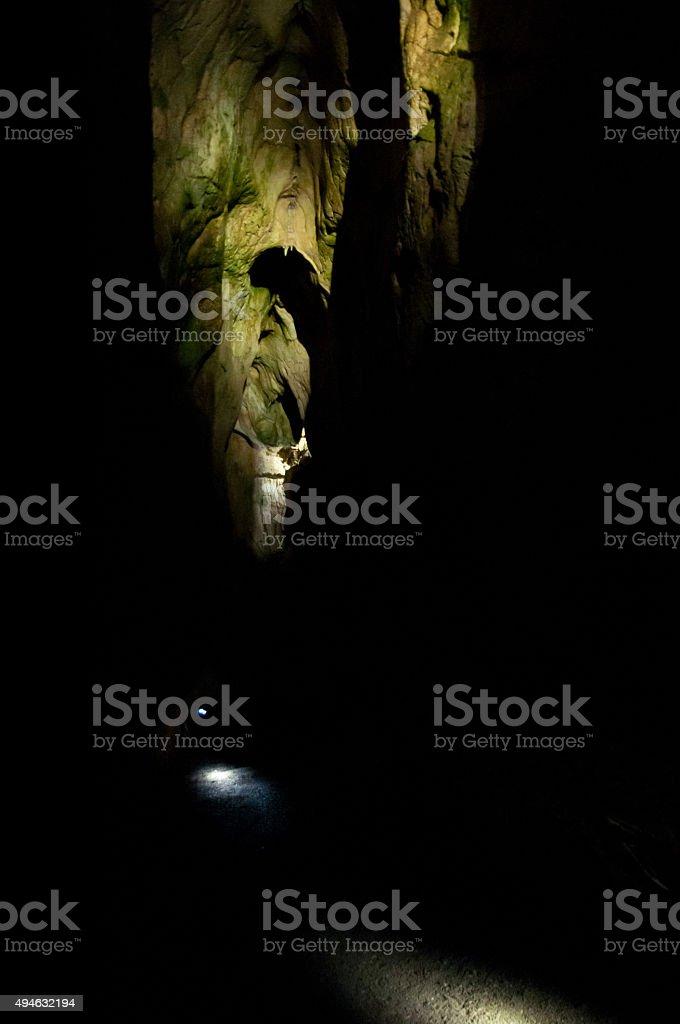 beautiful spotlight in cave stock photo
