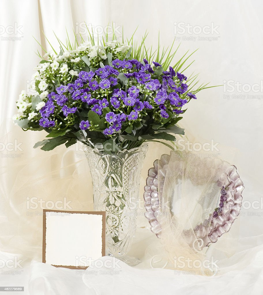 Beautiful spring flowers in a glass vase with banner add stock photo