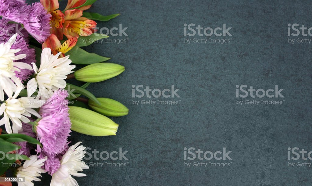 Beautiful Spring Flowers Over Blackboard Background stock photo